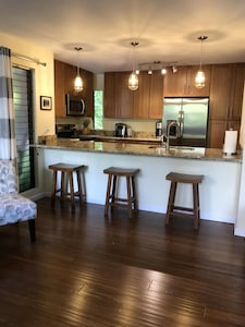 Living space has LED dimmer lighting in kitchen