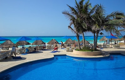Our access to Reef club has swimming pools, beach chairs, & beach volleyball