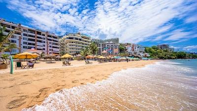 View of Playa Bonita condo building (left) from the beach