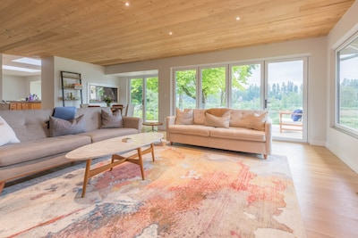 Beautiful spacious family room w/ panoramic views of river and 65 inch 4K TV