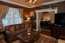 Cosy leather couches and huge flat screen in Merlot Cottage.