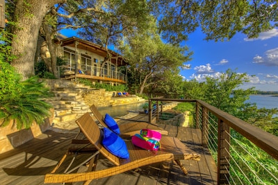 Pool/spa/decks built into the hillside banks of Lake Travis among the trees.