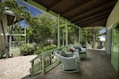 Great House Porch with Four Rockers Overlooking the Quiet Courtyard.