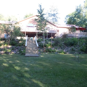 back of cabin and outdoor game area