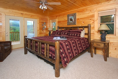 "Master Bedroom with 35"" TV, private adjoining bath, and deck access."
