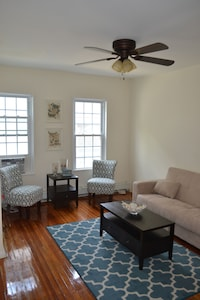 Living room with ceiling fan and AC