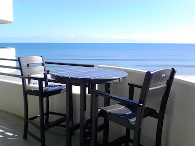 Beautiful ocean and pool views from pub table on balcony.