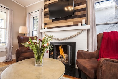 relax sitting by the fireplace watching a movie or playing cards