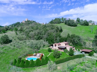 Aereal view of Tuscany villa: lawn and pool