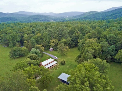 Our farmhouse, nestled at the foothills of Shenandoah National Park.