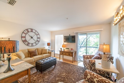 Beautiful family room with great view of the river. Comfy sleeper sofa.