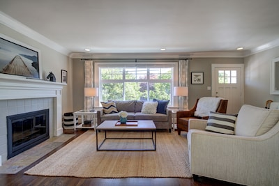 Spacious and bright living room with soundproofed windows.