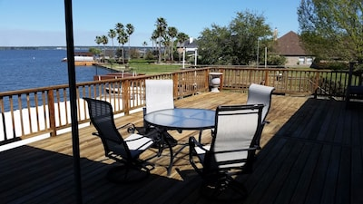 The table and four of the six chairs to view the lake