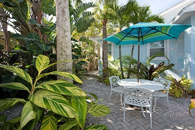 Outside sitting area surrounded by lush tropical vegetation