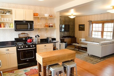 Full kitchen & adjacent living space