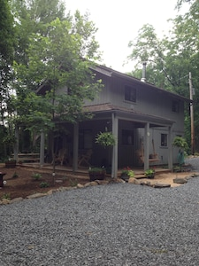 The cabin and surrounding parking