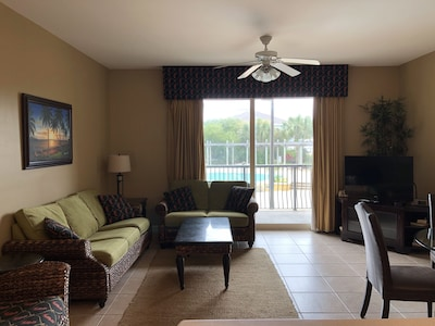 Kick back and relax in our open living room with plenty of seating and a TV!