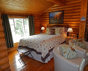 Beautiful Bedroom area with warm quilts for Julian winters, plus hardwood floors
