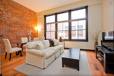 Spacious one bedroom loft with plenty of room in the living and dining area.
