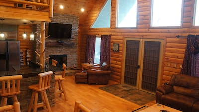 Amazing open feel with vaulted knotty pine ceiling.  Lots of natural light.