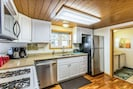 Kitchen includes a coffee maker, dishwasher, microwave and full set of dishes.