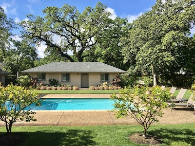 The Guest Cottage cottage is nestled under ancient Valley Oaks.