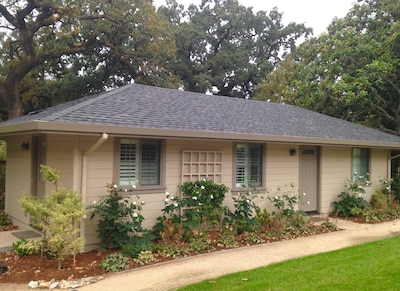 Guest Cottage exterior. Front door faces pool, side door opens on kitchen patio.