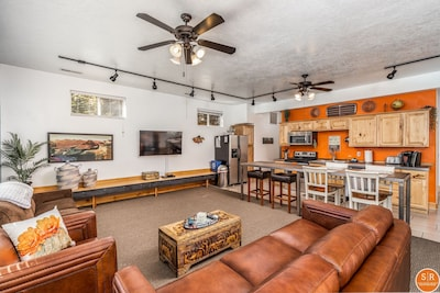 Super comfy and spacious living room! Leather couches and a hide-a-bed couch.