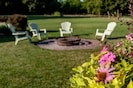 Enjoy the Fire Pit just off the front porch, perfect for the cooler evenings.