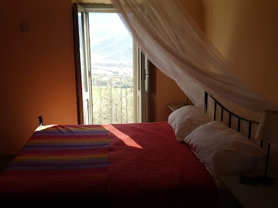 Downstairs double bedroom . Wake up to beautiful views