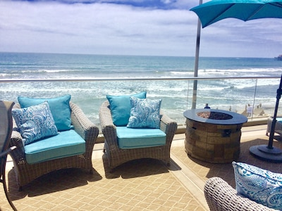 Stunning ocean views form spacious patio with fire pit
