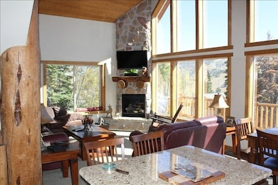 Main floor family room w/ fireplace and vaulted ceiling; unobstructed views