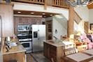 Kitchen provides a gas stove/oven, full fridge, microwave, dishwasher & island