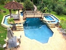 Enjoy the shared pool,  2-minute walk towards the other side of the property