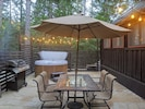 The flagstone enclosed patio hosts a four-person Sundance spa