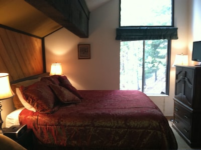 ENCLOSED BEDROOM LOFT WITH KING SIZE BED , TV & FULL BATH