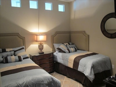 2nd bedroom with deluxe twin beds, flat screen TV and DVD player