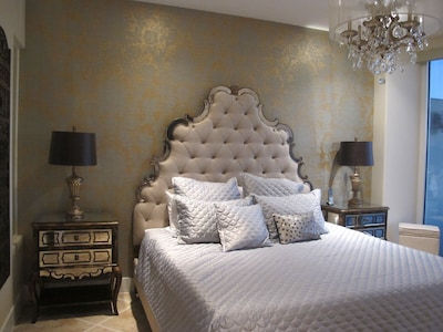 Gorgeous master suite with floor-to-ceiling views of the Gulf and 55 inch TV