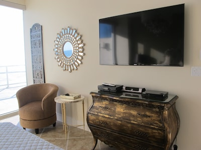 Sitting area in master bedroom and TV
