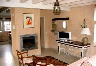 Living room, view from North East, with chimney