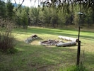 Here is our huge fire pit to sit around after a day of hiking or fishing,relax!!