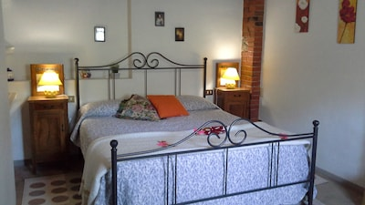 The bedroom area has a large double bed, wardrobe, chest of drawers , a sofa bed