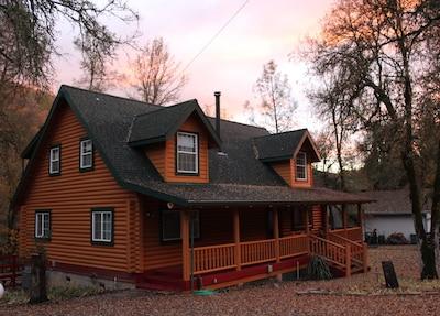 Beautiful custom log home with year-round stream in back yard