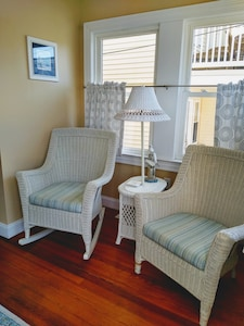 as you walk in you are greeted by a comfy sunroom area