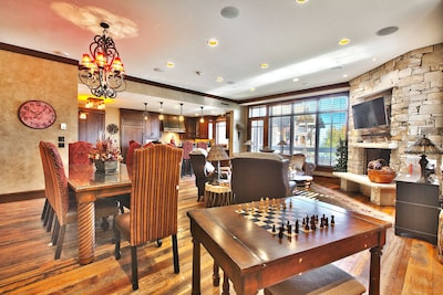 Enjoy a game of chess, checkers or cards while you watch skiers skiing by condo.