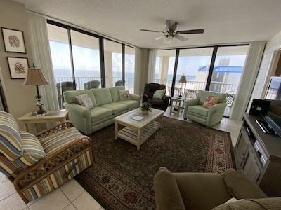 Living Area with ceiling to floor windows over looking the beach at Aquavista!