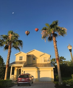 Palm trees, morning moon and hot air balloons…