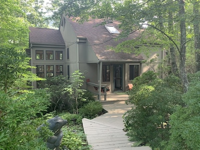 view of portion of house in summer