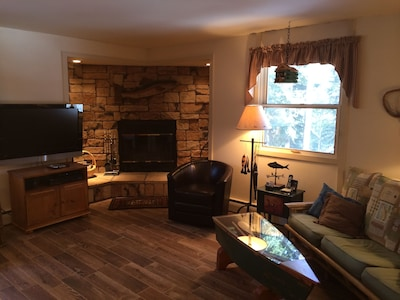 Cozy, fishing cabin theme throughout home.