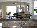 Elegant marble kitchen looks out onto dining room, living room & huge patio